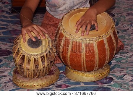 Closeup Of Fingers Of An Indian Child Playing Tabla Which Is A Traditional Musical Instrument