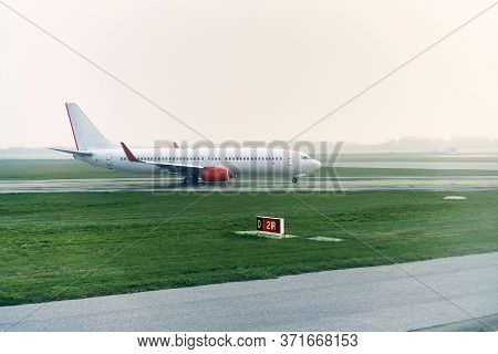 White Airplane Standing On The Airport Runway. Passenger Airplane Taking Off. Travel Concept