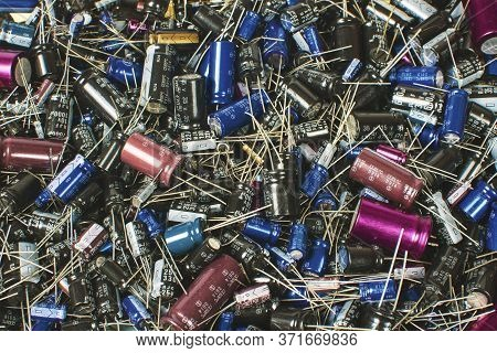 Close Up Of Electrolytic Capacitor Heap With Various Sizes Background