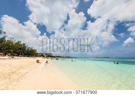 Nassau, Bahamas - May 3, 2019: People Relax On The Goodman's Bay Beach. Goodman's Bay Is A Public Be