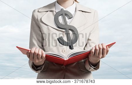 Businesswoman With Dollar Sign Above Opened Notebook. Investment And Money Saving Services. Close Up