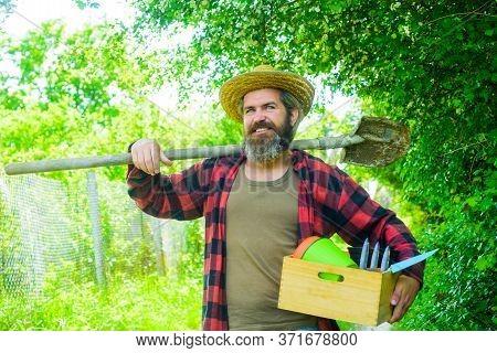 Gardener Work. Farm. Happy Bearded Man In Garden. Plants. Garden Tools. Gardening. Eco-farm. Work In