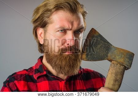 Man With Old Ax. Bearded Lumberjack. Bearded Man With Ax Beside Face. Portrait Of Man With Ax. Canad