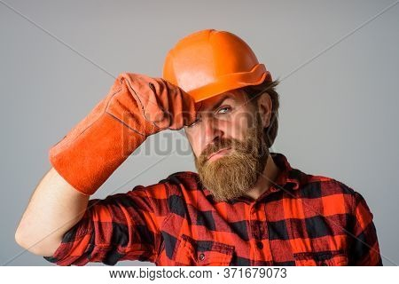 Bearded Workman In Hardhat. Builder With Work Gloves. Building, Industry, Technology. Builder In Har