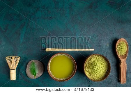 Set For Cooking Matcha Tea: Wooden Cups With Tea And Powder, Whisk, Spoon With Powder, Leaves Laid O