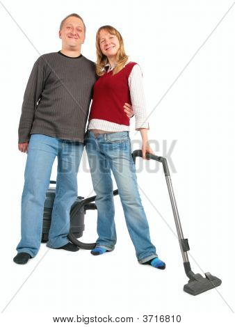 Man Embraces Woman With Vacuum Cleaner