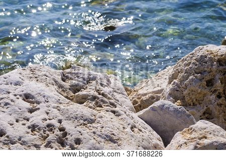 Turquoise Shallow Water Surface And Rocks Stones On Sea Floor. Shallow Transparent Green Sea Water R