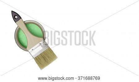 Paint Brush With A Wooden Handle On A Can Of Green Paint, Top View. White Background, Free Space For