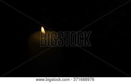 The Concept Of Mourning. A Burning Candle With Smoke On A Black Background, Free Space For Text.