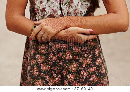 Girl with hands painted Mehandi