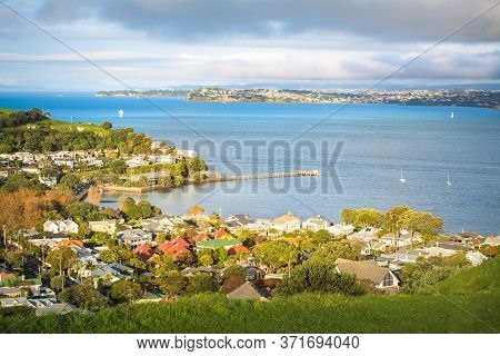Auckland Harbour And Historical Suburb Of Devonport Basking In Glorious Sunset.