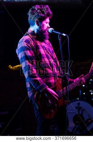 Man With Enthusiastic Face Holds Guitar, Singing Song, Play Music,