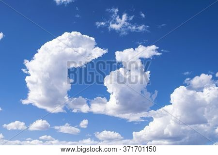 Picturesque Blue Sky With Bright And Shaped Clouds.