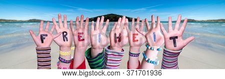 Children Hands Building Word Freiheit Means Freedom, Ocean Background