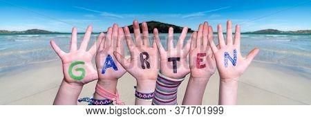 Children Hands Building Word Garten Means Garden, Ocean Background