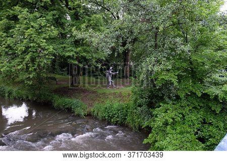 WASSERALFINGEN, GERMANY - MAY 05, 2014: Pilgrim to Santiago de Compostela statue by Sieger Koder in Wasseralfingen, Germany
