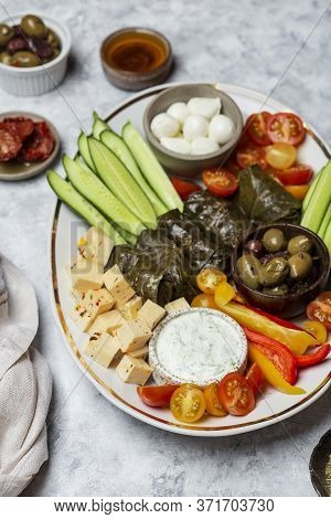 Middle Eastern Meze Platter With Vegetables, Cheese, Crowd And Tzatziki Sauce