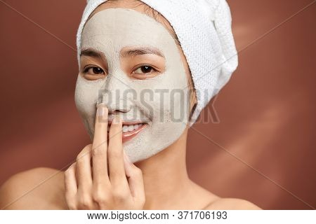 Young Woman Wearing Clay Mask On Her Face