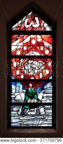 PIFLAS, GERMANY - JUNE 07, 2015: God cares for His own and strengthens them in their life path, stained glass window by Sieger Koder in St. John church in Piflas, Germany