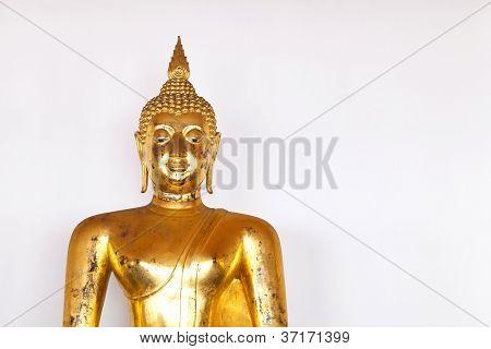 Golden Buddha Statue On White Wall