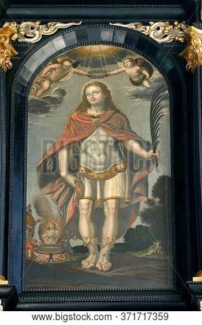 ZAGREB, CROATIA - MAY 16, 2013: Saint Vitus, altar of Saint Dionysius in the Church of Saint Catherine of Alexandria in Zagreb, Croatia