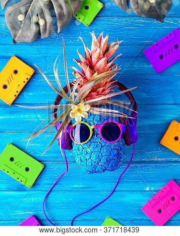 Retro 90s Disco Music Concept. Hipster Pineapple Character In Red Sunglasses And Earphones Listens T