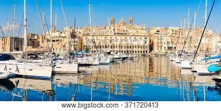 Sailing Boats On Senglea Marina In Grand Bay, Valetta, Malta, On A Bright Day With Blue Sly. Panoram