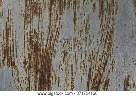 An Old Grey Wall, Texture, Background. Metallic Rusty Gray Surface With Residues And Stains Of Old P