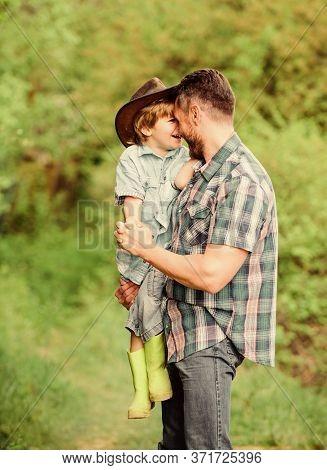 Child Having Fun Cowboy Dad. Farm Family. Holidays At Parents Farm. Growing Cute Cowboy. Weekend At