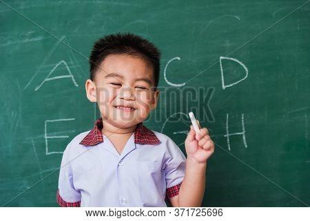 Back To School. Happy Asian Funny Cute Little Child Boy Kindergarten Preschool Smile In Student Unif