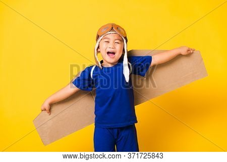 Happy Asian Handsome Funny Child Or Kid Little Boy Smile Wear Pilot Hat Playing And Goggles With Toy