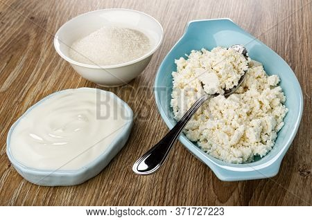 White Bowl With Sugar, Bowl With Sour Cream, Metallic Spoon In Blue Oval Bowl With Grainy Cottage Ch