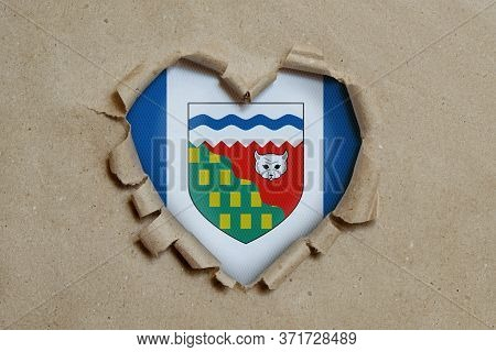 3d Illustration. Heart Shaped Hole Torn Through Paper, Showing Northwest Territories Flag