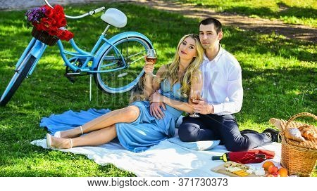 Couple Drinking Wine Sunny Day. Attractive Couple Enjoying Romantic Sunset Picnic In Countryside. Cu