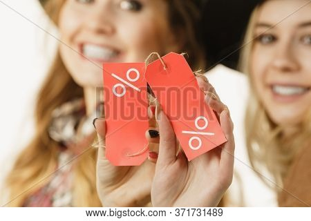 Two Woman After Sale Shopping