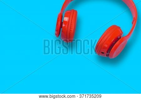 Red Headphones With Smartphone On Blue Pastel Color Background With Copy Space, Flat Lay Design Trav