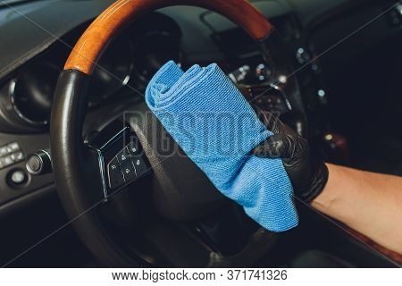 A Man Cleaning Car Seat With Microfiber Cloth. Car Detailing Or Valeting Concept. Selective Focus. C