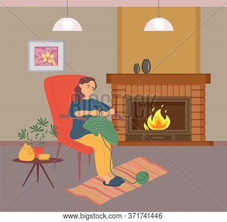 Woman Knitting, Female In Slippers Sitting On Chair Near Fireplace, Table With Teapot And House-plan