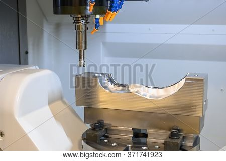 The 5 Axis Cnc Machining Center Cutting The Automotive Mold Parts With Solid Ball Endmill Tools. The