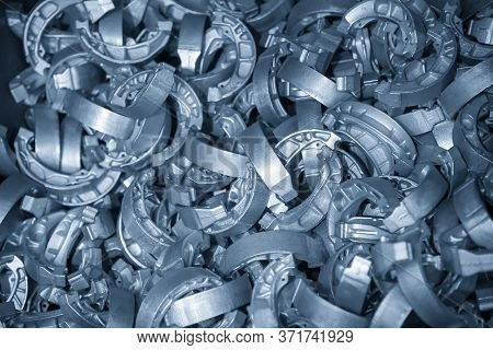 The Pile Of Aluminium Casting Parts Of Drum Brake. The Automotive Parts Manufacturing Process By Die