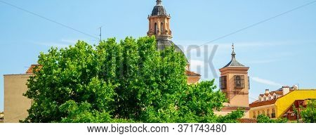 View Of The City Rooftops In Summer. Panoramic Views And Rooftops, Sky With Cloud. Long Banner