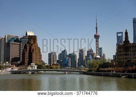 Shanghai, China - April 13, 2017: Wusong (suzhou) River In Shanghai, China With A Road Bridge And Bu