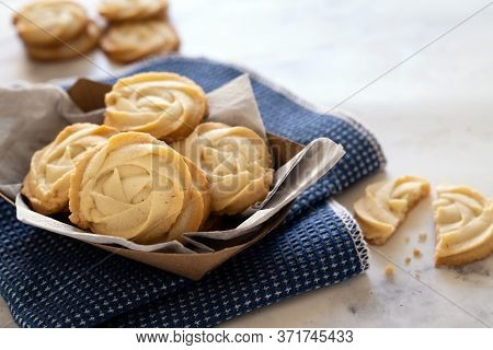 Butter Cookies In Paper Basket With Blue Table Cloth