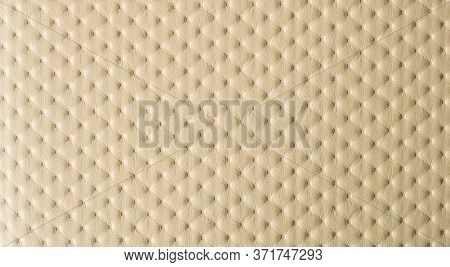 Light beige faux leather upholstery as a background