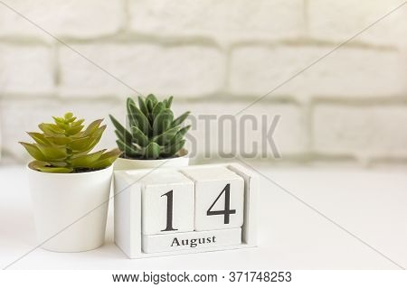 August 14 On A Wooden Calendar Next To The Alarm Clock. Summer Day, Empty Space For Text.calendar Fo