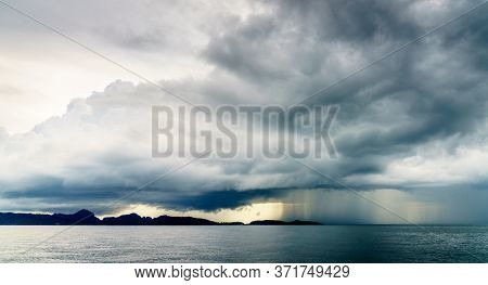 Rain storm and low clouds over the Andaman Sea off Krabi coast in Thailand