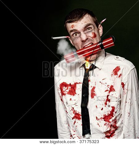Zombie Suicide Bomber Holding Explosives In Mouth