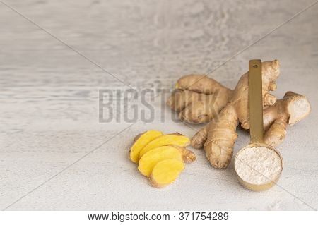 Ginger Roots And Ginger Rginger Powder On White Background. Ginger Used As Spice For Food And Treatm