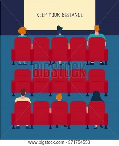 Social Distance In The Cinema. There Are Few People In The Cinema Hall, It Almost Empty. People Keep