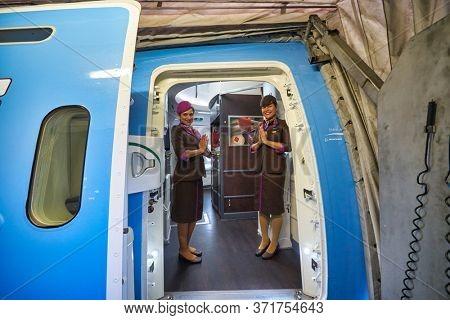 BANGKOK, THAILAND - CIRCA JANUARY, 2020: crew members of Etihad Airways meet passengers. Etihad Airways is the flag carrier of the UAE.